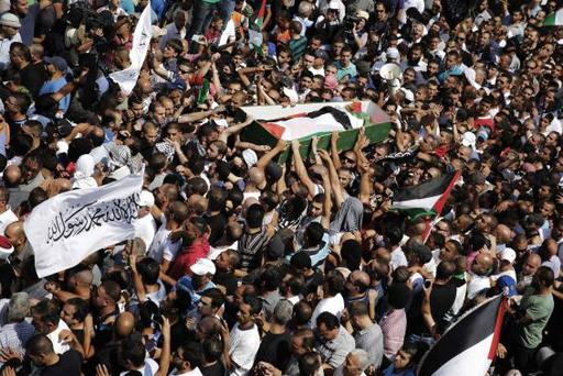 Palestinians carry the body of 16-year-old Mohammed Abu Khudair during his funeral in Shuafat, an Arab suburb of Jerusalem July 4, 2014. REUTERS/Finbarr O'Reilly