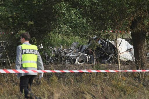 A policeman inspects the site of the crash of the Piper PA-31 Navajo plane in Topolow near Czestochowa July 5, 2014. Eleven people were feared killed on Saturday after the plane taking them on a parachute jump crashed in southern Poland shortly after take off, spokespeople for emergency medical services and fire services said. REUTERS/Maciej Kuron/Agencja Gazeta