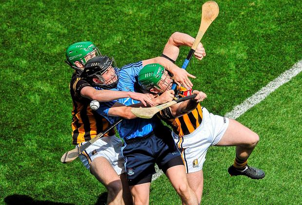 Dublin's David O'Callaghan is caught between Joey Holden (left) and Paul Murphy during the Leinster SHC final at Croke Park. Photo: Dáire Brennan / SPORTSFILE