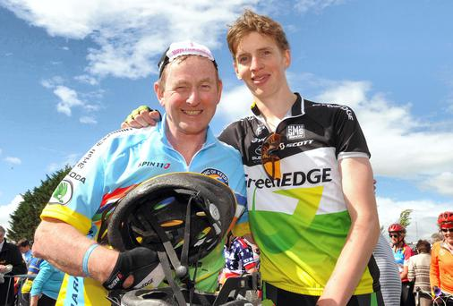 Taoiseach Enda Kenny with his son Ferdia after completing the annual Ring of Kerry cycle in Killarney on Saturday evening. Picture: Eamonn Keogh (MacMonagle, Killarney). The Taoiseach could be one of the disappointed fans if Garth Brooks' gigs are cancelled.