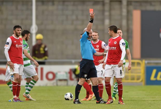 Keith Fahey, St Patrick's Athletic, is shown a red card by referee Padraig Sutton