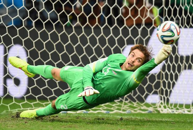 Tim Krul saves Costa Rica player Michael Umana's penalty kick to win the World Cup quarter-final penalty shootout for the Netherlands. Photo: Jamie McDonald/Getty Images