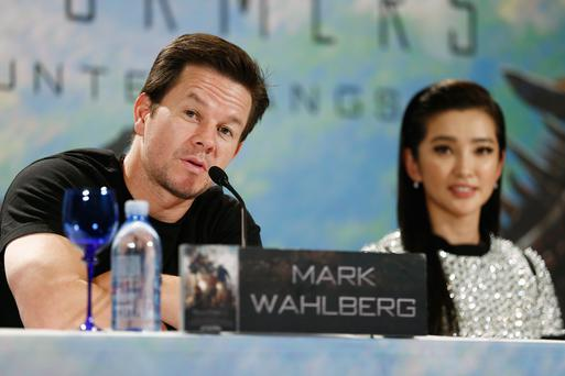 Actors Mark Wahlberg and Li Bingbing attend the Transformers: Age of Extinction press conference at Ritz Hotel on June 30, 2014 in Berlin, Germany.