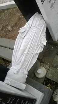 A statue of Holy Mary on Catherine Cleary's parents' grave was removed from the plinth, smashed and beheaded, along with several others in the graveyard. (Photo: Catherine Cleary)