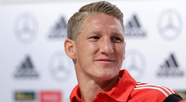 German national soccer player Bastian Schweinsteiger attends a news conference in Santo Andre near Porto Seguro