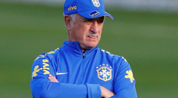 Luiz Felipe Scolari deep in thought during a Brazil training session ahead of their World Cup semi-final clash with Germany. Photo: REUTERS/Marcelo Regua