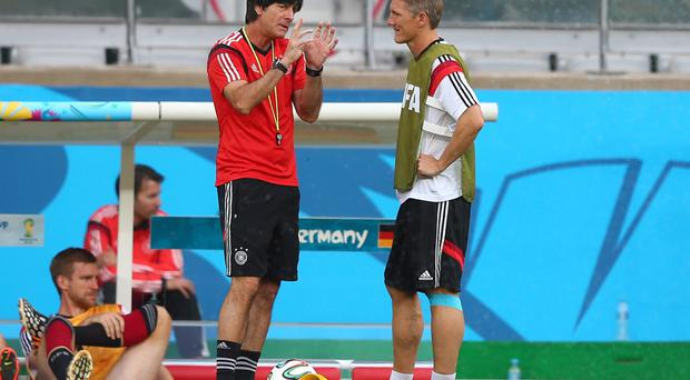 Germany coach Joachim Loew talks to midfielder Bastian Schweinsteiger during a training session ahead of their World Cup semi-final against Brazil. Photo: Martin Rose/Getty Images