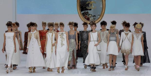 Models present creations by German designer Karl Lagerfeld at the end of his Haute Couture Fall/Winter 2014-2015 fashion show for French fashion house Chanel. Reuters