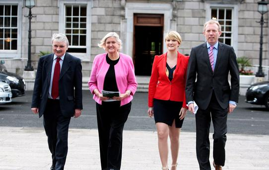 Willie O'Dea,TD,Fianna Fail spokesperson on Social Protection, Senators Mary White and Averil Power and Timmy Dooley,TD meet the media at Leinster House yesterday ahead of the Fianna Fail motion last night calling for the immediate suspension of a review of the free travel pass. Picture: Tom Burke