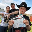 10 year old Garth Brooks fan Cameron Cloke from Enniscorthy, Co.Wexford photographed with his parents Donna Marie and Michael. Photo: Mary Browne