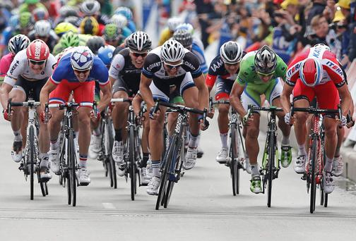 Giant Shimano rider Marcel Kittel powers to the line to take the win on stage four of the Tour de France in Lille. Photo: AP Photo/Peter Dejong