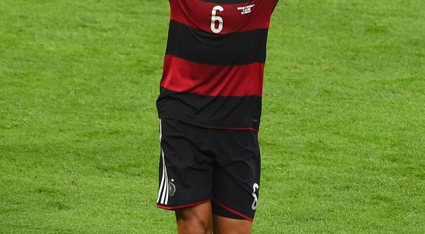 Sami Khedira of Germany celebrates scoring his team's fifth goal during the 2014 FIFA World Cup Brazil Semi Final match between Brazil and Germany at Estadio Mineirao