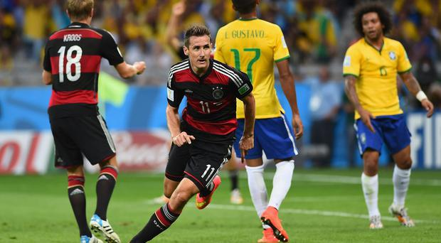 Germany's Miroslav Klose celebrates scoring his record-breaking goal against Brazil which took him to the top of the list of all-time World Cup goalscorers. Photo: Laurence Griffiths/Getty Images