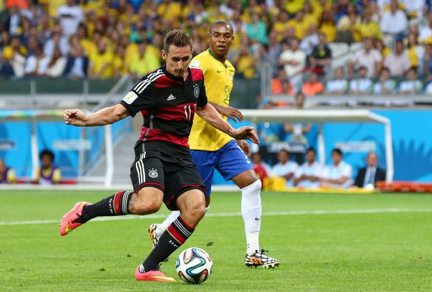 Miroslav Klose shoots to score Germany's second goal in the World Cup semi-final against Brazil. Photo: Robert Cianflone/Getty Images