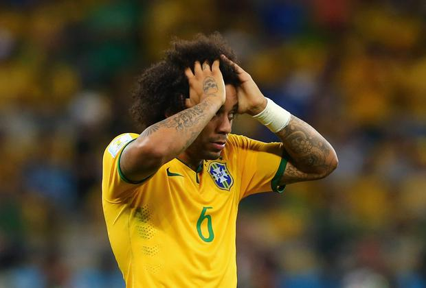 Marcelo holds his head in his hands after the Germans score another goal to pile the pain on for Brazil in the World Cup semi-final. Photo: Martin Rose/Getty Images