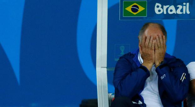 Brazil's coach Luiz Felipe Scolari reacts during his team's 2014 World Cup semi-finals against Germany at the Mineirao stadium in Belo Horizonte