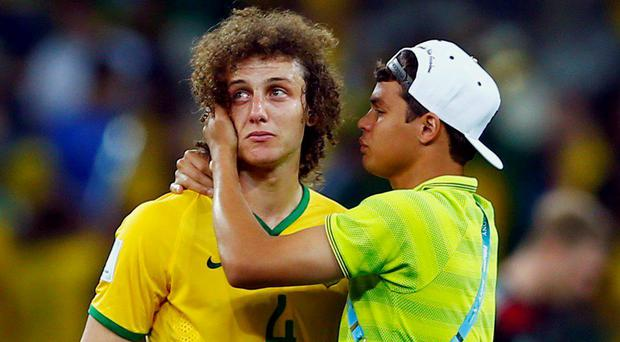 Brazil's David Luiz is consoled by team-mate Thiago Silva after their World Cup semi-final defeat to Germany at Mineirao stadium in Belo Horizonte. Reuters