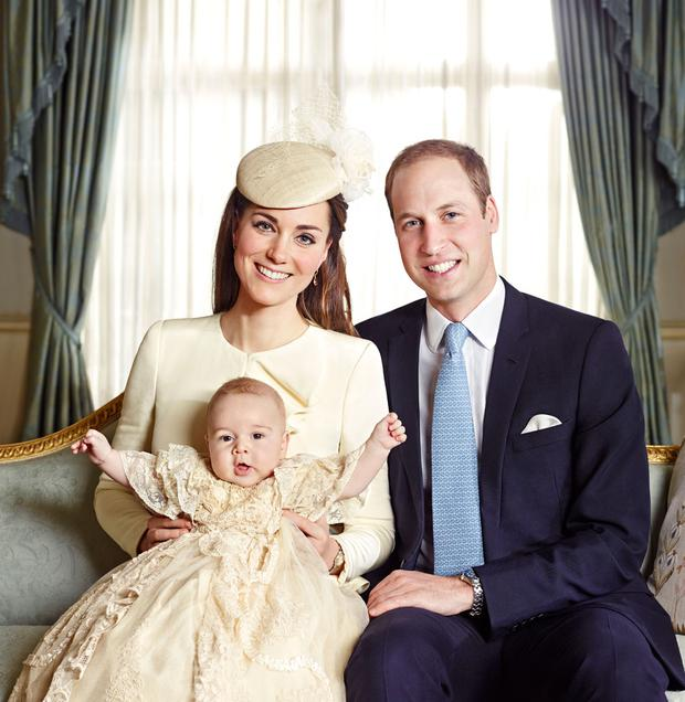 Prince William and Kate Middleton holding Prince George after his Christening