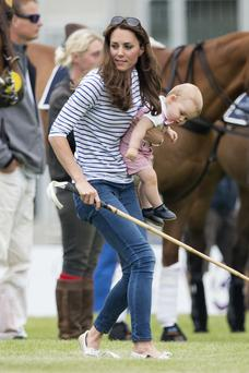 Kate Middleton and Prince George last month at the polo