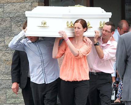 Zoe's step dad Eddie Murphy, aunt Anna O'Sullivan and uncle Anthony Scannell pictured carrying her coffin at the funeral mass of Zoe Scannell at the Church of the Assumption Abbeyfeale, Co. Limerick. Picture: Press 22