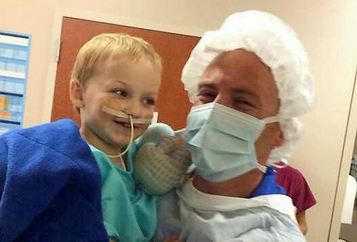 Gavin Glynn with his dad John in hospital in Houston, Texas