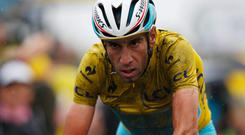 Italy's Vincenzo Nibali of the Astana team crosses the line to take third place on the gruelling fifth stage of the Tour de France and retain the yellow jersey. Photo: Harry Engels/Getty Images