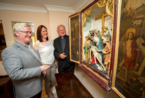 From left, Philip Sheppard, Tracy McHugh (niece of Fr. O'Reilly) and Fr. John O'Reilly, parish priest Piercetown Co. Wexford with a 15th century Flemish Altarpiece at Sheppards Irish Auction House in Durrow, Co Laois. Picture: Dylan Vaughan