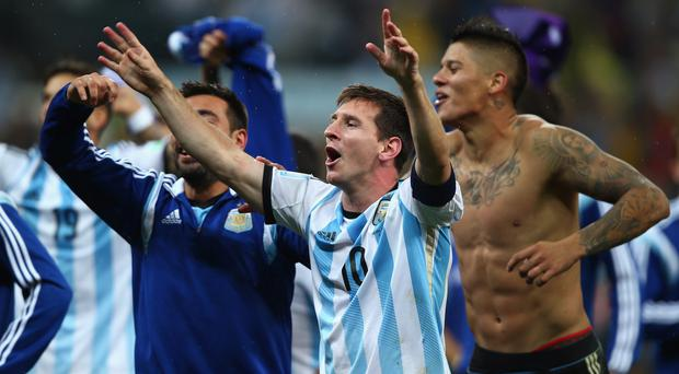Lionel Messi of Argentina celebrates defeating the Netherlands in a shootout during the 2014 FIFA World Cup Brazil Semi Final match between the Netherlands and Argentina at Arena de Sao Paulo
