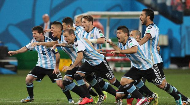 Lionel Messi leads the way as Argentina players celebrate after Maxi Rodriguez struck the winning penalty against the Netherlands in the World Cup semi-final in Sao Paolo. Photo: Dean Mouhtaropoulos/Getty Images