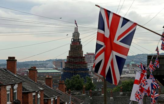 A bonfire is seen erected on the Shankill Road in West Belfast. The bonfire will be set alight on Friday, ahead of theTwelfth of July celebrations held by members of the Orange Order. Reuters
