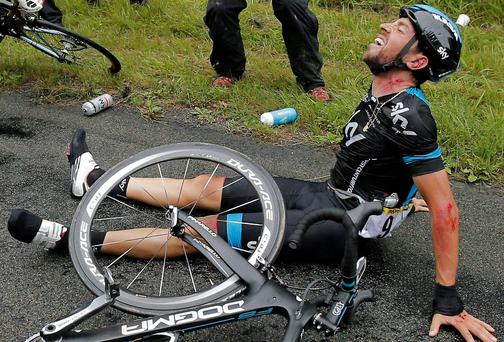 Spain's Xabier Zandio of Team Sky sits on the road after crashing out of the Tour de France during yersterday's sixth stage. Photo credit: AP Photo/Christophe Ena