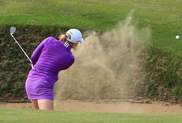 Stephanie Meadow of Northern Ireland hits her 3rd shot on the 9th hole during the first round of the Ricoh Women's British Open at Royal Birkdale in Southport, England. Photo credit: David Cannon/Getty Images