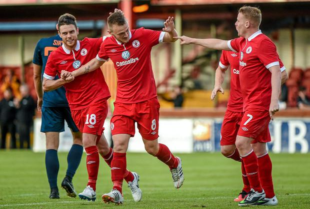 Sligo Rovers' David Cawley, second left, celebrates with team-mates, from left, John Russell, Aaron Greene and Danny North, after scoring his side's fourth goal of the game. UEFA Europa League First Qualifying Round, Second Leg, Sligo Rovers v Banga. Showgrounds, Sligo. Picture credit: Ramsey Cardy / SPORTSFILE