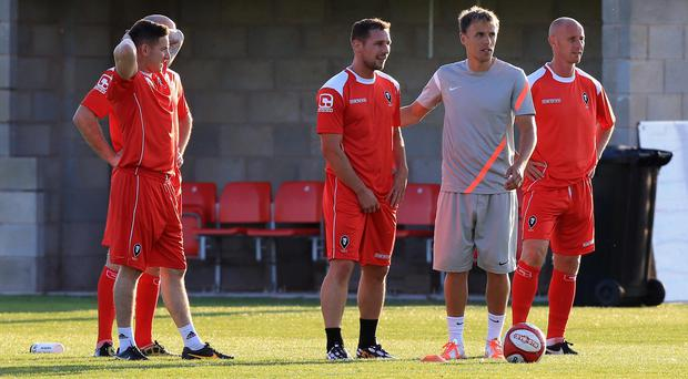 Phil Neville and Nicky Butt help with training with the Salford City F.C. team at the AJ Bell Stadium, Salford. PRESS ASSOCIATION Photo. Picture date: Thursday July 10, 2014. Manchester United's famous 'Class of 92' hope their stewardship of Salford City will yield