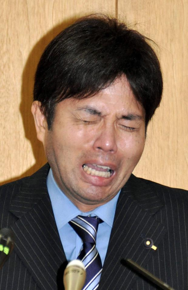 In this Tuesday, July 1, 2014 photo, Hyogo Prefectural assemblyman Ryutaro Nonomura cries during a press conference in Kobe, western Japan. A video clip of Nonomura accused of dubious spending has gone viral, leaving many outraged and puzzled. The video shows Nonomura, 47, bursting into tears, uttering nonsensical phrases and banging on the desk. One site for the video drew nearly 640,000 views, as of Thursday. (AP Photo/Kyodo News) JAPAN OUT, MANDATORY CREDIT