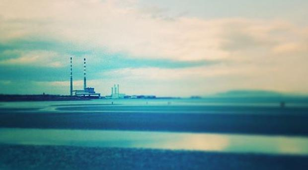 Poolbeg chimneys from across Sandymount Strand (Photo: Denise Calnan)
