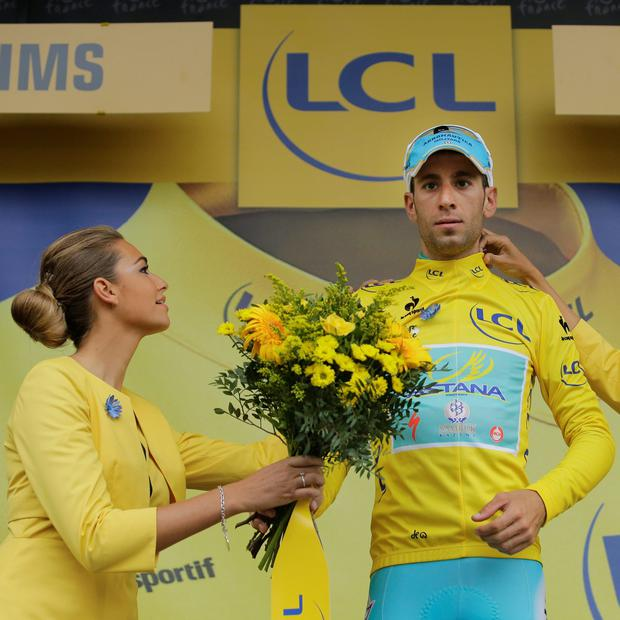 Italy's Vincenzo Nibali, wearing the overall leader's yellow jersey, celebrates on the podium of the sixth stage of the Tour de France cycling race over 194 kilometers (120.5 miles) with start in Arras and finish in Reims, France, Thursday, July 10, 2014. Picture: AP/Laurent Cipriani.