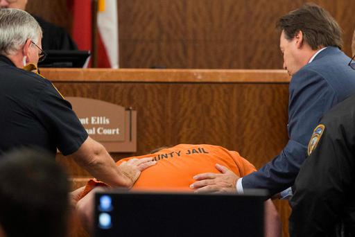 Accused mass shooter Ronald Lee Haskell collapses as he appears in court on in Houston, Texas July 11, 2014