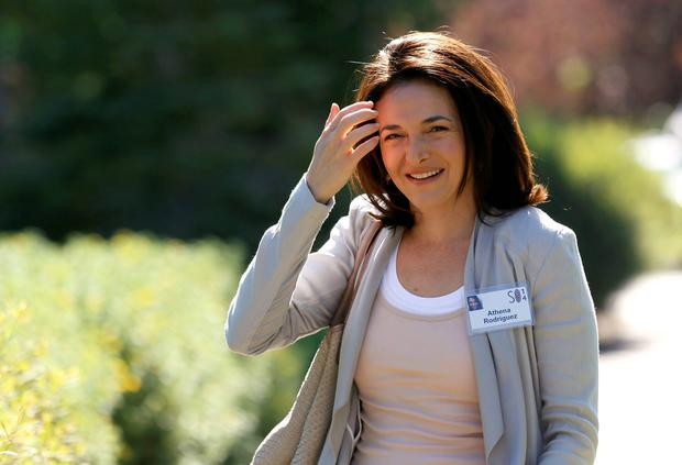 Sheryl Sandberg, COO of Facebook, wearing someone else's ID badge, arrives for the third day of the Allen and Co. media conference in Sun Valley, Idaho. Reuters