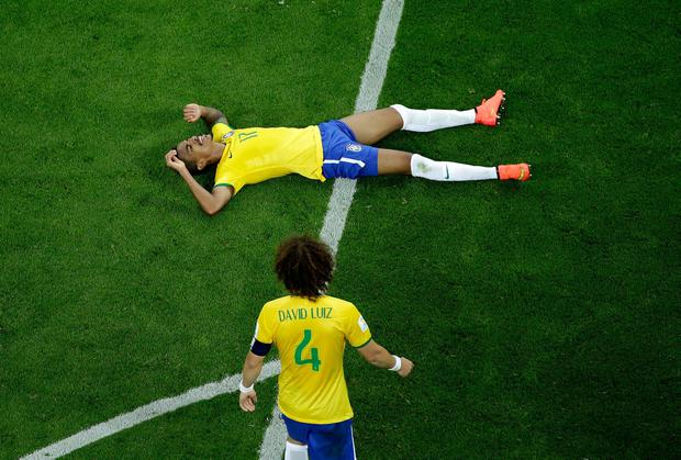 Brazil's David Luiz and Luiz Gustavo try to take it all in after their heavy World Cup semi-final defeat to Germany. Photo: Felipe Dana - Pool/Getty Images