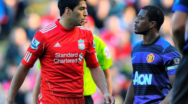 In just one of the many incidents - but perhaps more notable for the wrong reasons - during his time at Liverpool, Luis Suarez exchanges words with Manchester United's Patrice Evra, who claimed the Uruguayan had racially abused him several times during the match. Photo: ANDREW YATES/AFP/Getty Images