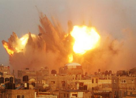 A ball of fire is seen following an early morning Israeli air strike on Rafah in the southern of Gaza strip. Getty Images