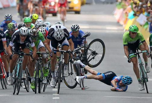 United States rider Andrew Talansky of the Garmin-Sharp team crashes during the sprint to the finishing line in stage seven of the the Tour de France from Epernay to Nancy. Photo: Doug Pensinger/Getty Images