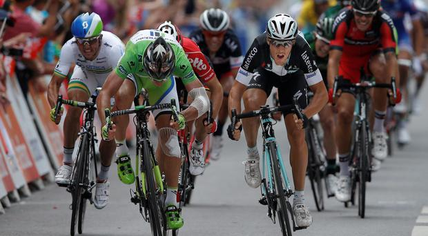 Italy's Matteo Trentin (right) crosses the finish line ahead of Slovakian rider Peter Sagan to win the seventh stage of the Tour de France from Epernay and finishing in Nancy. Photo: AP Photo/Peter Dejong