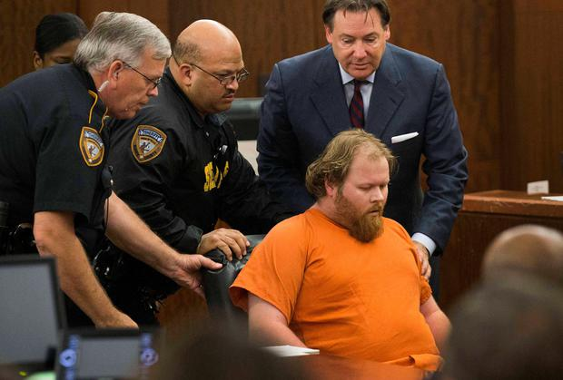 Accused mass shooter Ronald Lee Haskell is wheeled from the courtroom after collapsing during a hearing in Houston, Texas. Haskell is accused of killing four children aged 4 to 14 and their parents in the Houston suburb of Spring. Reuters