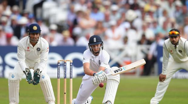 England batsman Joe Root plays a reverse-sweep to pick up some runs during his unbeaten 78 on day three of the first Test against India at Trent Bridge. Photo: Stu Forster/Getty Images