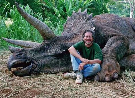 Steven Spielberg on the set of Jurassic Park with a mechanical dinosaur