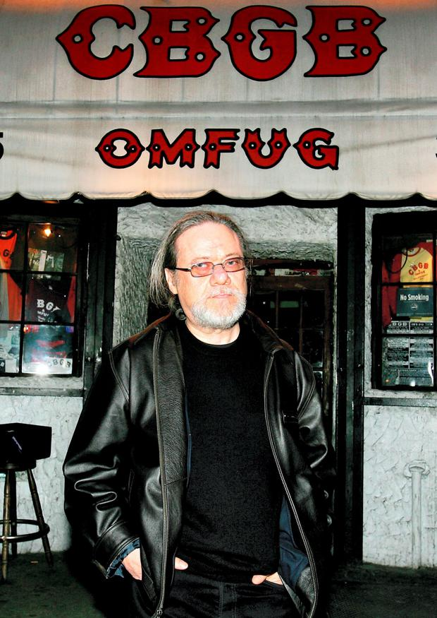 Tommy Ramone poses in front of the legendary club CBGB during the premiere of the film Punk Attitude