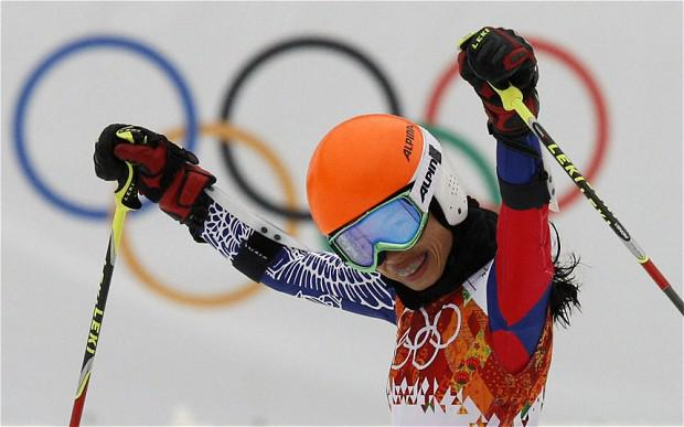Violinst Vanessa Mae celebrating at the Sochi 2014 Winter Olympics