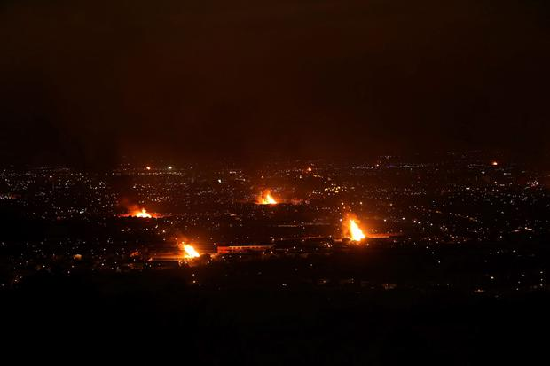11th night bonfires are seen across Belfast, where traditionally bonfires are lit across the province at midnight to mark the victory of King William III's victory over James II at the Battle of the Boyne in 1690